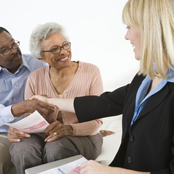 financial-advisor-assisting-senior-couple