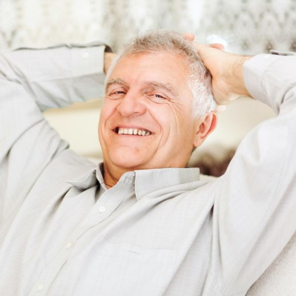 happy-senior-man-relaxing-at-home