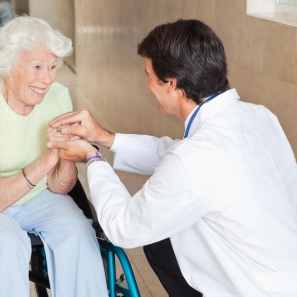 doctor-comforting-happy-senior-woman